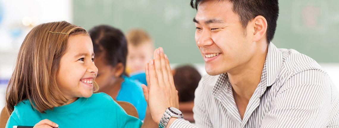 teacher high-fiving student