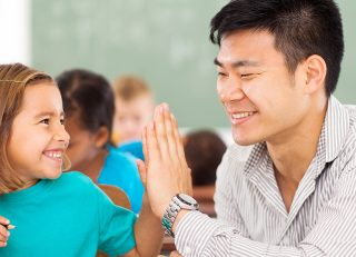 teacher high-fiving student