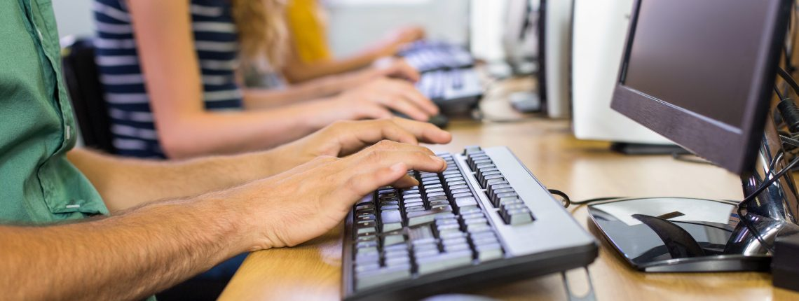 people typing on computer keyboards