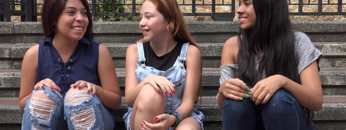 teenagers talking and laughing