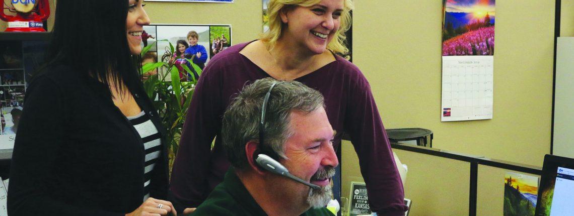 CRISC staff around a computer