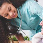 nurse smiling at a patient