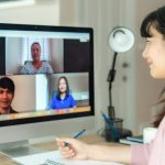 Woman talking to other people on videoconference