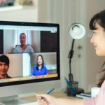 person videconferencing with teammates