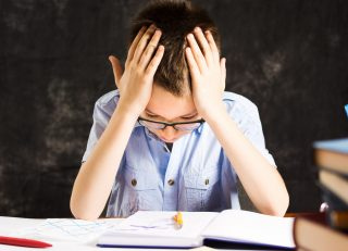 Boy having problems in finishing homework