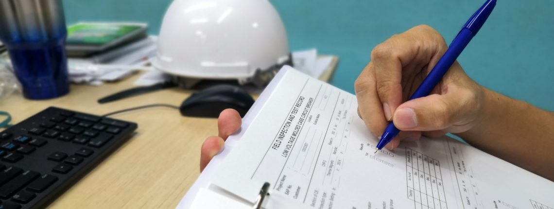 Worker filling out an inspection