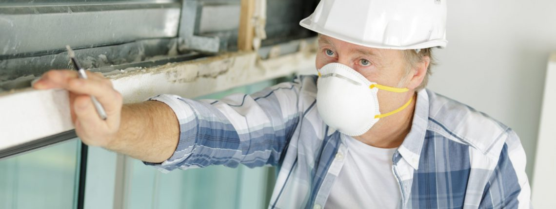 man wearing a mask performing an inspection