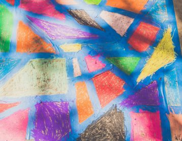 Kid's sidewalk chalk art abstract with tape