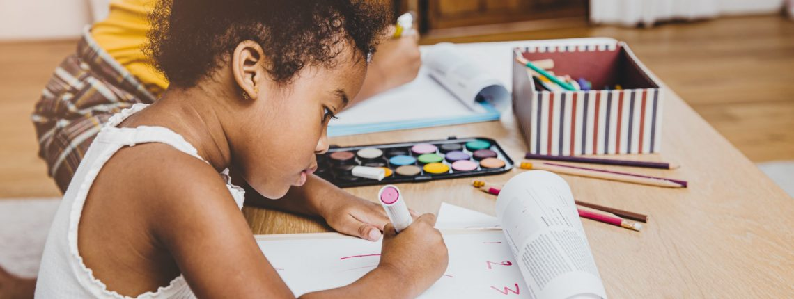 Young child doing schoolwork at home