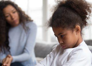 Mom talking with upset child