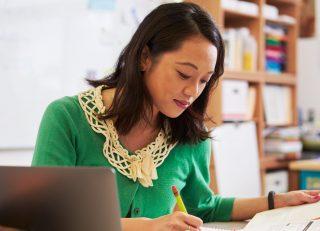 Female teacher working at her desk.