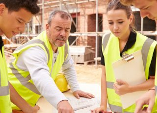 People talking at a construction site