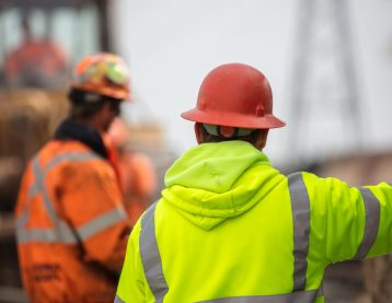 Two men at a construction site.