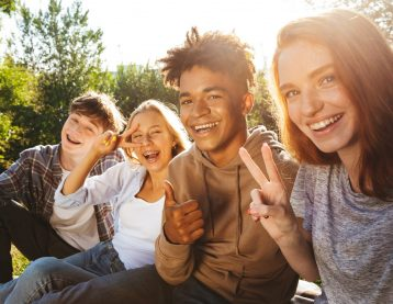 Four teenagers smiling