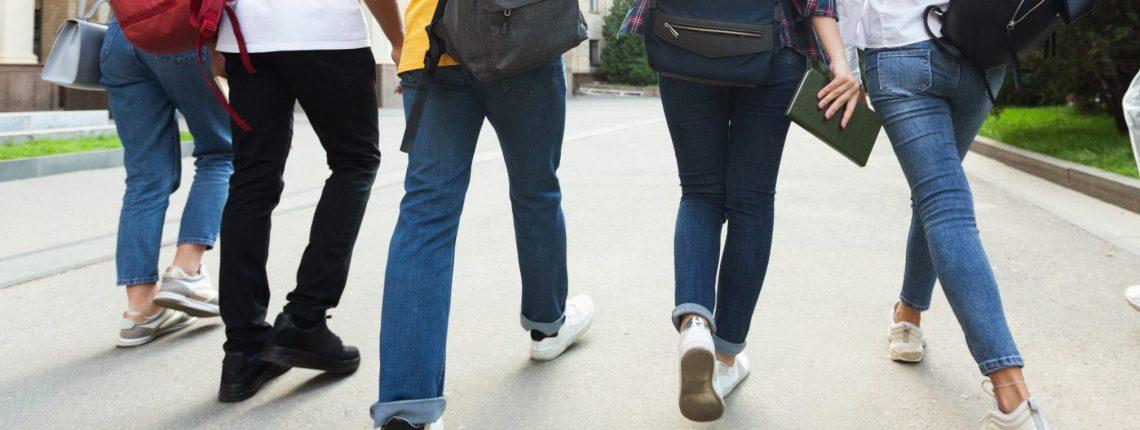 Teenagers with backpacks walking