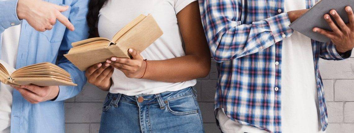 Diverse people with books in their hands